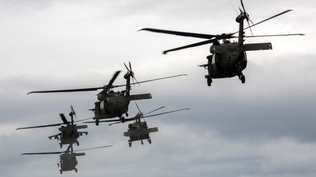 many black helicopters in the sky