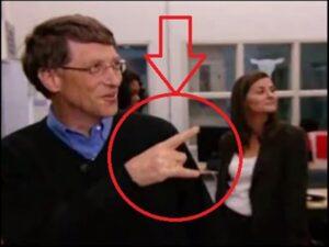 Bill Gates making devil horns sign