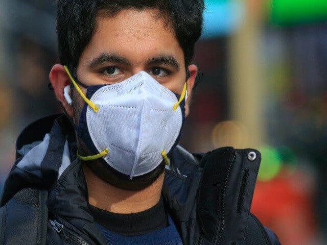 man wearing double mask